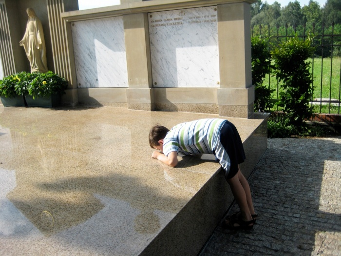 Kissing tomb of St. Faustina